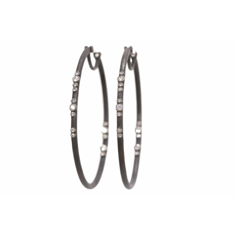 Ss Scattered Diamond Elongated Hoop Earrring